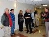 Curator Sharon Carson, right, leads guests on a tour of the hospital installation.