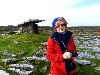 Astrid in the Burren with an ancient tomb.